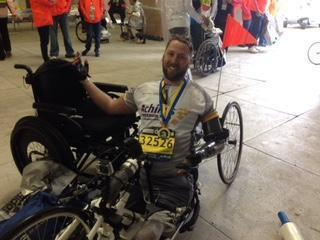Army veteran and triple amputee Adam Keys after finishing 2015 Boston Marathon in his handcycle.